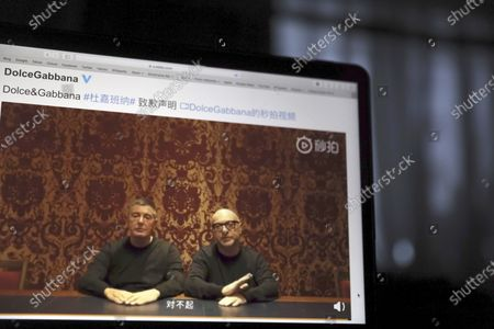 "Founders of Dolce&Gabbana Domenico Dolce, left and Stefano Gabbana apologize in a video on Chinese social media, saying ""sorry"" in Mandarin seen on a computer screen in Beijing, China. The Milan fashion house Dolce&Gabbana filed a multi-million-dollar defamation suit in an Italian court against U.S. fashion bloggers who reposted anti-Asian comments attributed to one of the designers that led to a boycott by Asian consumers. The suit was filed in Milan civil court in 2019, but only became public this week, when the bloggers posted about it on their Instagram profile, Diet Prada"