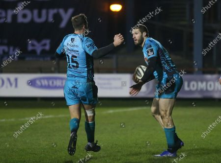 Jonah Holmes of Dragons celebrates with Josh Lewis of Dragons after scoring try