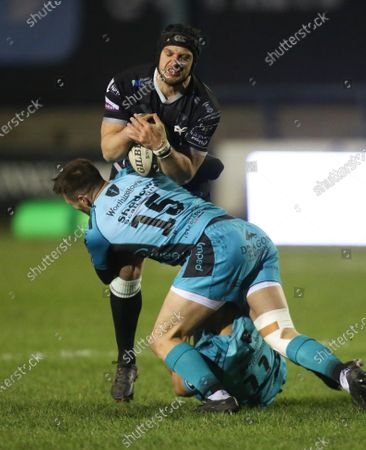 Dan Evans of Ospreys is tackled by Josh Lewis of Dragons and Ashton Hewitt of Dragons