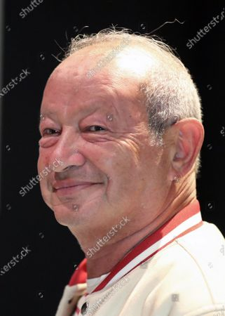 Stock Photo of Egyptian businessman Naguib Sawiris attends the Opening of Mu'anath Exhibition in Cairo, Egypt, 06 March 2021. The Mu'anath exhibition will explore the feminine appropriation rooted in Egypt's cultural identity through photography, painting, and sculpture.
