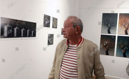 Stock Image of Egyptian businessman Naguib Sawiris attends the Opening of Mu'anath Exhibition in Cairo, Egypt, 06 March 2021. The Mu'anath exhibition will explore the feminine appropriation rooted in Egypt's cultural identity through photography, painting, and sculpture.
