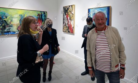 Egyptian businessman Naguib Sawiris attends the Opening of Mu'anath Exhibition in Cairo, Egypt, 06 March 2021. The Mu'anath exhibition will explore the feminine appropriation rooted in Egypt's cultural identity through photography, painting, and sculpture.