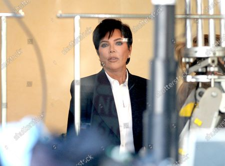 Stock Picture of Kris Jenner on set wearing a face shield to protect against the coronavirus