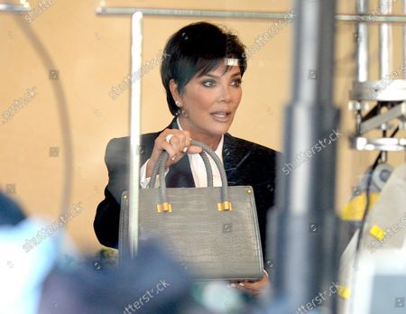 Stock Image of Kris Jenner on set wearing a face shield to protect against the coronavirus