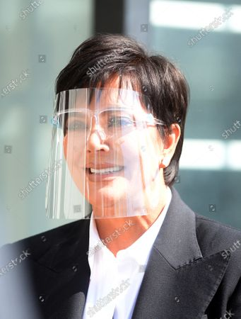 Kris Jenner on set wearing a face shield to protect against the coronavirus
