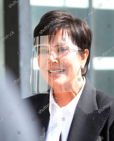 Stock Photo of Kris Jenner on set wearing a face shield to protect against the coronavirus