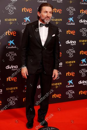 Antonio de la Torre poses for the photographers on the red carpet during the 35th Goya Awards Ceremony at Soho CaixaBank Theater in Malaga, Andalusia, Spain, 06 March 2021.