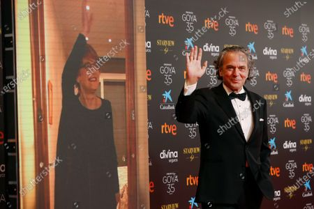 Jose Coronado (R) poses for the photographers on the red carpet during the 35th Goya Awards Ceremony at Soho CaixaBank Theater in Malaga, Andalusia, Spain, 06 March 2021.