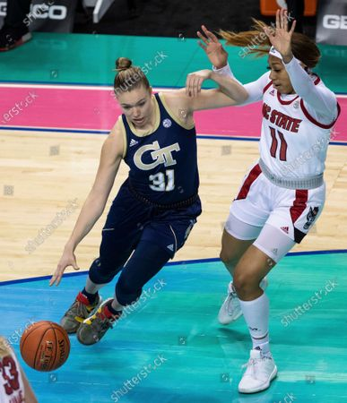 Georgia Tech's Lotta-Maj Lahtinen (31) drives as North Carolina State's Jakia Brown-Turner (11) defends during an NCAA college basketball game in the semifinals of Atlantic Coast Conference tournament in Greensboro, N.C