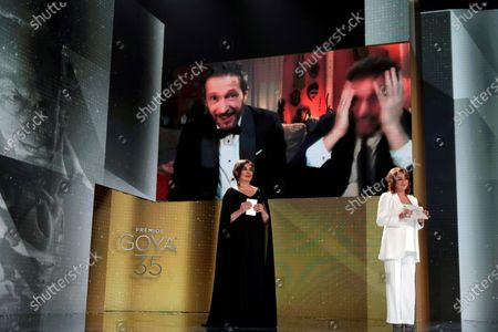 A handout picture provided by Premios Goya shows Spanish Salvador Calvo (on screen, L) after receiving 'Best Director' Goya award for the film 'Adu' during the 35th Goya Awards Ceremony gala at Soho CaixaBank Theater in Malaga, Andalusia, Spain, 06 March 2021.