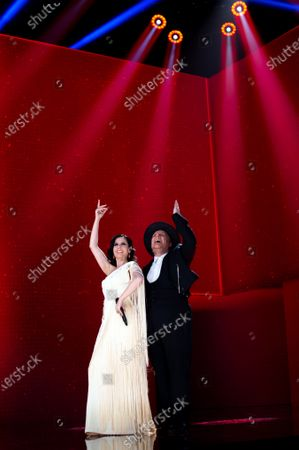 A handout picture provided by Premios Goya shows Spanish singer Diana Navarro (L) and Spanish humorist Carlos Latre (R) performing as a tribute to Spanish film director Luis Garcia-Berlanga during the 35th Goya Awards Ceremony gala at Soho CaixaBank Theater in Malaga, Andalusia, Spain, 06 March 2021.