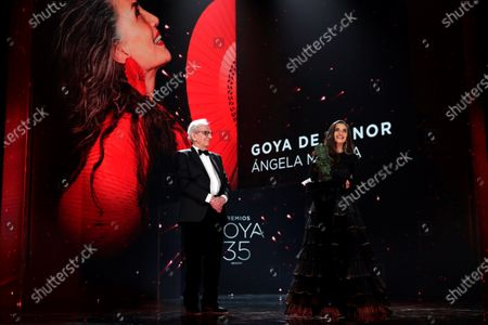 A handout picture provided by Premios Goya shows Spanish actress Angela Molina (R), next to Spanish film director Jaime Chavarri (L), after receiving the Goya of Honor Award during the 35th Goya Awards Ceremony gala at Soho CaixaBank Theater in Malaga, Andalusia, Spain, 06 March 2021.