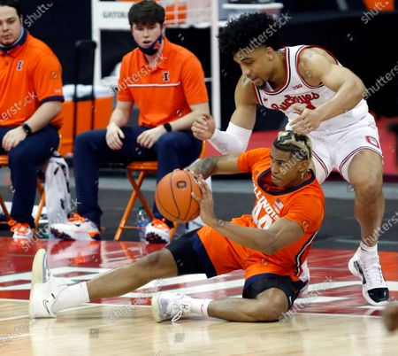 Illinois guard Adam Miller, bottom, passes against Ohio State forward Justice Sueing during the first half of an NCAA college basketball game in Columbus, Ohio