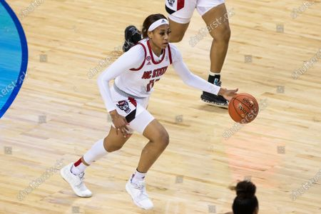 North Carolina State's Jakia Brown-Turner (11) handles the ball during the semifinals of Atlantic Coast Conference NCAA women's college basketball game in Greensboro, N.C