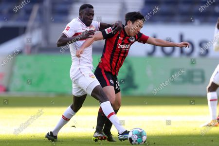 Makoto Hasebe (R) of Eintracht Frankfurt is challenged by Silas Wamangituka of VfB Stuttgart