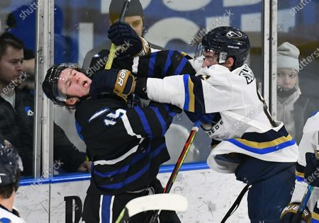 Stock Picture of Sioux Falls Stampede Brent Johnson (6) cross checks Fargo Force Cody Monds (15) during a USHL game between the Sioux Falls Stampede and the Fargo Force at Scheels Arena in Fargo, ND. He was assessed a two minute penalty