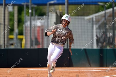 Stetson's Elizabeth Jackson (2) runs after hitting a pitch during an NCAA softball game against Toledo, in Leesburg, Fla