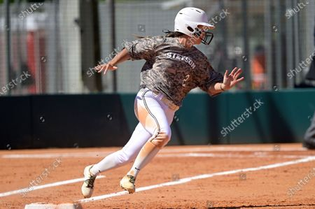 Stock Photo of Stetson's Elizabeth Jackson (2) runs after hitting a pitch during an NCAA softball game against Toledo, in Leesburg, Fla