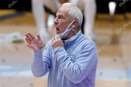 North Carolina head coach Roy Williams directs his players during the first half of an NCAA college basketball game against Duke in Chapel Hill, N.C