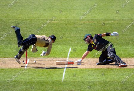 Stock Photo of NZ's Tim Seifert unsuccessfully tries to stump Aaron Finch (right) during the 5th international men's T20 cricket match between the New Zealand Black Caps and Australia at Sky Stadium