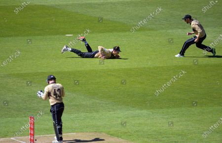 NZ's Mitch Santner catches Aaron Finch during the 5th international men's T20 cricket match between the New Zealand Black Caps and Australia at Sky Stadium