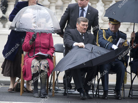 Camilla, Duchess of Cornwall Sarah Brown and Secretary for Defence, Bob Ainsworth having trouble with his umbrella