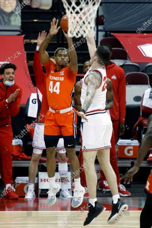 Illinois guard Adam Miller, left, goes up for a shot against Ohio State forward Kyle Young during an NCAA college basketball game in Columbus, Ohio, . Illinois won 73-68