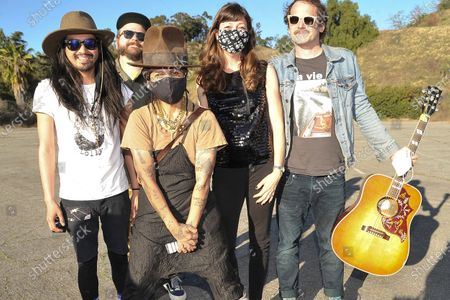 Stock Photo of Linda Perry, center, poses with the Silversun Pickups during Rock 'N' Relief, in Los Angeles