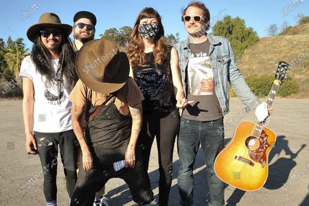 Stock Picture of Linda Perry, center, poses with the Silversun Pickups during Rock 'N' Relief, in Los Angeles