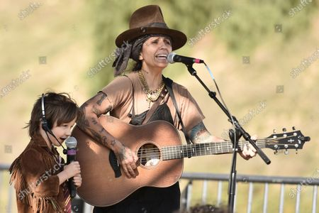 """Stock Image of Linda Perry and her son Rhodes perform """"What's? Up"""" during Rock 'N' Relief, in Los Angeles"""