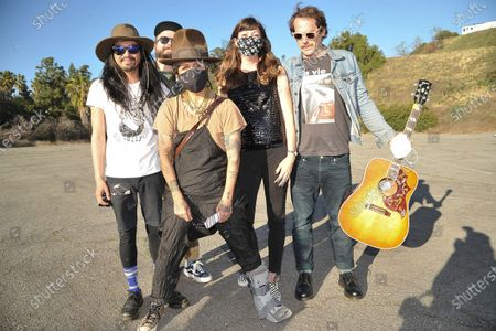 Linda Perry, front, poses with the Silversun Pickups during Rock 'N' Relief, in Los Angeles