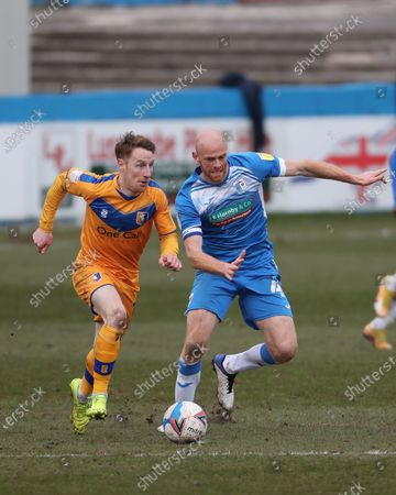 Stephen Quinn of Mansfield Town in action with Barrow's Jason Taylor   during the Sky Bet League 2 match between Barrow and Mansfield Town at the Holker Street, Barrow-in-Furness on Saturday 6th March 2021.