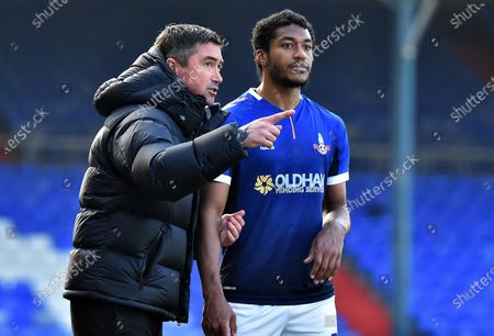 Stock Photo of Oldham Athletic's Harry Kewell (Head Coach) and Oldham Athletic's Raphal Diarra during the Sky Bet League 2 match between Oldham Athletic and Southend United at Boundary Park, Oldham on Saturday 6th March 2021.