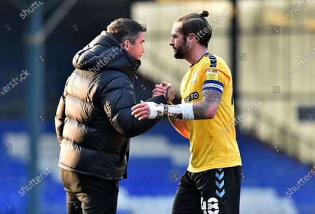 Oldham Athletic's Harry Kewell (Head Coach) and John White of Southend United after the Sky Bet League 2 match between Oldham Athletic and Southend United at Boundary Park, Oldham on Saturday 6th March 2021.