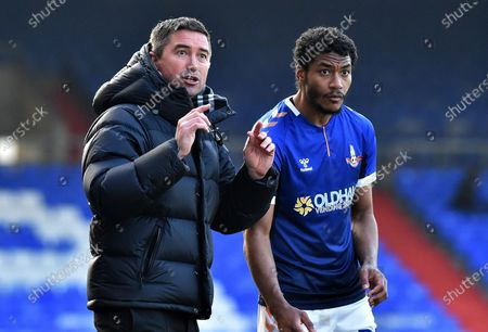 Oldham Athletic's Harry Kewell (Head Coach) and Oldham Athletic's Raphal Diarra during the Sky Bet League 2 match between Oldham Athletic and Southend United at Boundary Park, Oldham on Saturday 6th March 2021.