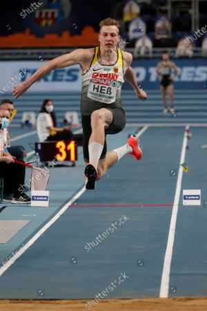 Germany's Max Hess competes in the triple jump during the European Athletics Indoor Championships in Torun, Poland