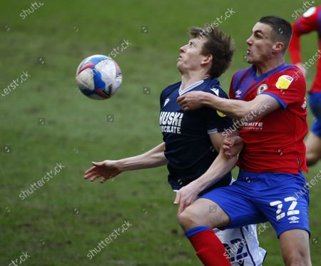 L-R Jon Dadi Bodvarsson of Millwall and Blackburn Rovers' Taylor Harwood-Bellis (on loan from Manchester City) during The Sky Bet Championship between Millwall and Blackburn Rovers at The Den Stadium, London on 06th March 2021