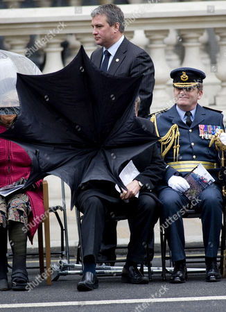 Secretary for Defence, Bob Ainsworth having trouble with his umbrella