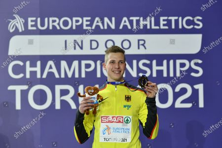 Stock Image of Bronze medalist Max Hess of Germany  poses for a photo during the medal ceremony in the men's Tiple Jump competition at the 36th European Athletics Indoor Championships in Torun, north-central Poland, 07 March 2021.