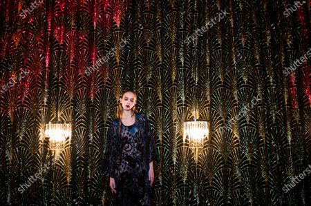 Argentinian model Moira Berntz poses during the shooting of a video presentation of French fashion designer Alexis Mabille Women's Fall/Winter 2021/2022 collection at Le Boeuf sur le Toit restaurant in Paris, France, 04 March 2021 (issued 07 March 2021). Amid the Covid19 pandemic, the Paris Fashion Week remains a purely digital event. Due to a curfew from 6pm daily and the ban on public gatherings, more than 90 brands had to adopt an online format to present their Fall/Winter collections. Mabille showcased his collection at the famed restaurant Le Boeuf sur le Toit, after redesigning its interior a year ago. Founded in 1922, this brasserie and music hall reopened on February 2020 after five months of renovations, but closed several days later because of the first national lockdown.