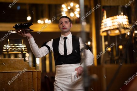 French actor Maxime Nourissat poses during the shooting of a video presentation of French fashion designer Alexis Mabille Women's Fall/Winter 2021/2022 collection at Le Boeuf sur le Toit restaurant in Paris, France, 04 March 2021 (issued 07 March 2021). Amid the Covid19 pandemic, the Paris Fashion Week remains a purely digital event. Due to a curfew from 6pm daily and the ban on public gatherings, more than 90 brands had to adopt an online format to present their Fall/Winter collections. Mabille showcased his collection at the famed restaurant Le Boeuf sur le Toit, after redesigning its interior a year ago. Founded in 1922, this brasserie and music hall reopened on February 2020 after five months of renovations, but closed several days later because of the first national lockdown.
