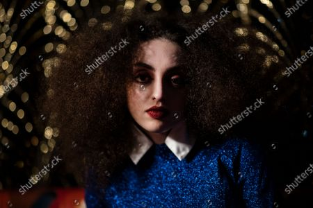 French model Clara Benador poses during the shooting of a video presentation of French fashion designer Alexis Mabille Women's Fall/Winter 2021/2022 collection at Le Boeuf sur le Toit restaurant in Paris, France, 04 March 2021 (issued 07 March 2021). Amid the Covid19 pandemic, the Paris Fashion Week remains a purely digital event. Due to a curfew from 6pm daily and the ban on public gatherings, more than 90 brands had to adopt an online format to present their Fall/Winter collections. Mabille showcased his collection at the famed restaurant Le Boeuf sur le Toit, after redesigning its interior a year ago. Founded in 1922, this brasserie and music hall reopened on February 2020 after five months of renovations, but closed several days later because of the first national lockdown.