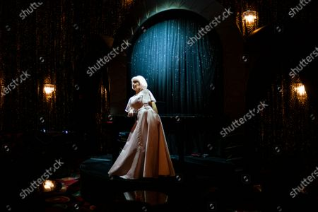 French artist Marie Beltrami poses during the shooting of a video presentation of French fashion designer Alexis Mabille Women's Fall/Winter 2021/2022 collection at Le Boeuf sur le Toit restaurant in Paris, France, 04 March 2021 (issued 07 March 2021). Amid the Covid19 pandemic, the Paris Fashion Week remains a purely digital event. Due to a curfew from 6pm daily and the ban on public gatherings, more than 90 brands had to adopt an online format to present their Fall/Winter collections. Mabille showcased his collection at the famed restaurant Le Boeuf sur le Toit, after redesigning its interior a year ago. Founded in 1922, this brasserie and music hall reopened on February 2020 after five months of renovations, but closed several days later because of the first national lockdown.
