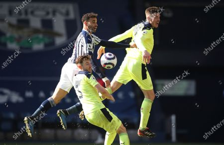West Bromwich Albion's Hal Robson-Kanu, top left, vies for the ball with Newcastle's Ciaran Clark, top right and Newcastle's Paul Dummett during the English Premier League soccer match between West Bromwich Albion and Newcastle United at the Hawthorns in Birmingham, England