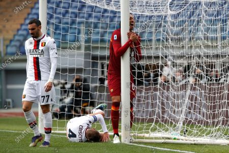 Roma's Chris Smalling, right, reacts after missing a scoring chance during a Serie A soccer match between Roma and Genoa at Rome's Olympic stadium