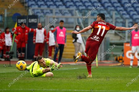 Genoa's goalkeeper Federico Marchetti, left, saves a shot by Roma's Pedro Rodriguez, during a Serie A soccer match between Roma and Genoa at Rome's Olympic stadium