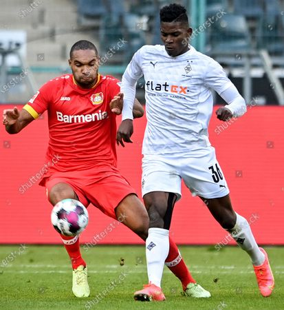 Jonathan Tah (L) of Leverkusen vies with Breel Embolo of Moenchengladbach during a German Bundesliga football match between Borussia Moenchengladbach and Bayer 04 Leverkusen in Moenchengladbach, Germany, March 6, 2021.