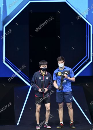 Dimitrij Ovtcharov (R) of Germany and Lin Yun-Ju of Chinese Taipei pose with their trophies during the awarding ceremony after the men's singles final at WTT Contender Doha in Doha, Qatar on March 6, 2021. Dimitrij Ovtcharov defeated Lin Yun-Ju to claim the title.