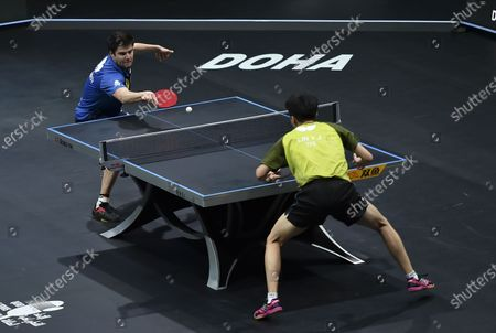 Dimitrij Ovtcharov (L) of Germany competes during the men's singles final against Lin Yun-Ju of Chinese Taipei at WTT Contender Doha in Doha, Qatar on March 6, 2021. Dimitrij Ovtcharov defeated Lin Yun-Ju to claim the title.
