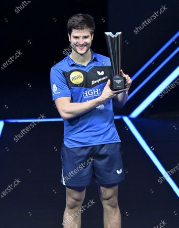 Dimitrij Ovtcharov of Germany poses with winner's trophy during the awarding ceremony after the men's singles final against Lin Yun-Ju of Chinese Taipei at WTT Contender Doha in Doha, Qatar on March 6, 2021. Dimitrij Ovtcharov defeated Lin Yun-Ju to claim the title.